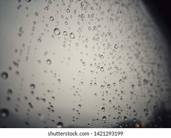 Close up shot of some rain droplets on a glass.