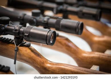 Close up shot of some rifles with scopes.