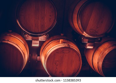 Close up shot of some wine barrels in a cellar.
