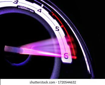 Close up shot of a speedometer in a car. At an engine speed of 6000 rpm on Car dashboard.Car Interior ilumination.