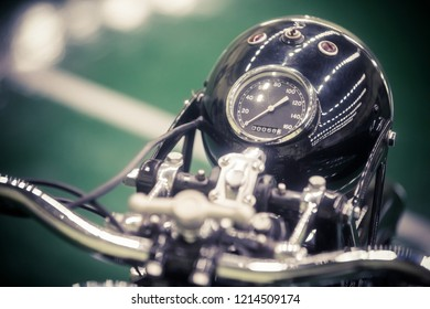 Close up shot with the speedometer of a vintage motorcycle.