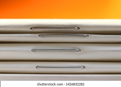 Close up shot of stack of thin books