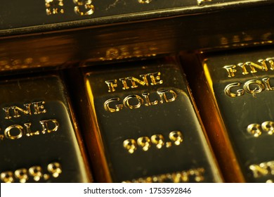 close up shot of stacked 999.9 pure gold bar ingot on a black background, represented the business, invesment and finance concept idea