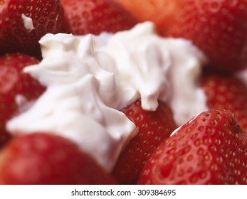 Close up shot of strawberries and cream