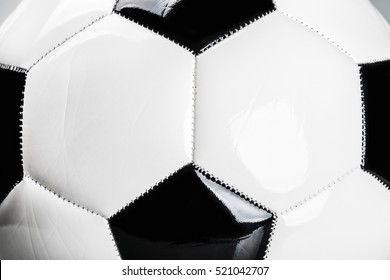close up shot of traditional black and white football