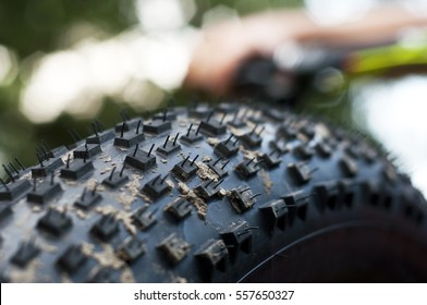 Close up shot of the tread on a fat mountain bike tire.