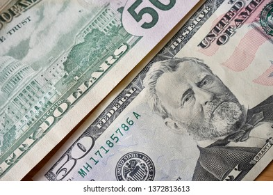 Close Up Shot of Two Fifty Dollar Bills