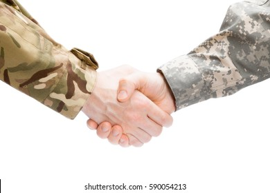 Close up shot of two military men shaking hands on white background