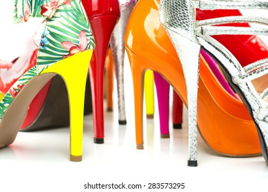 close up shot of various stiletto high heels in different colors, lots of copy space. PLEASE NOTE: all used shoes are no-name product from a chinese outdoor-market and no branded designer products.