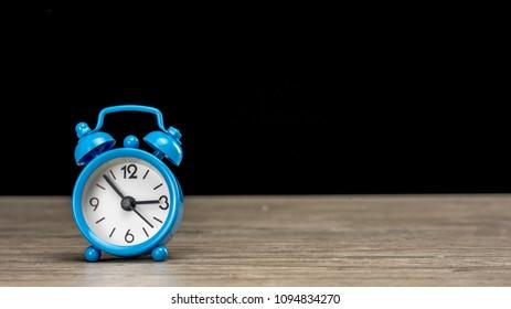 Close up shot of a vintage alarm clock