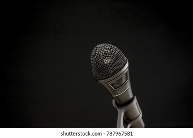 Close up shot of a vintage black microphone