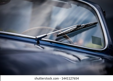 Close up shot of vintage car windscreen wipers.