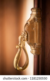 Close up shot of a vintage metal window lever.