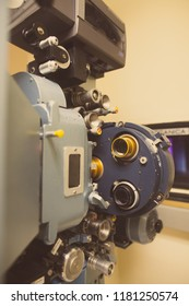 Close up shot of a vintage movie projector in a cinema hall.