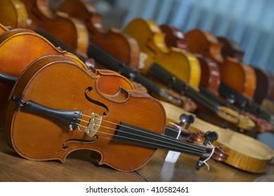 Close up shot of  violins in workshop