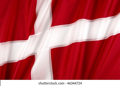 Close up shot of wavy, red and white Danish flag