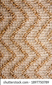 Close up shot of weaving tapestry rug or carpet texture. Typical South American or African weaving pattern. Brown and beige color palette.