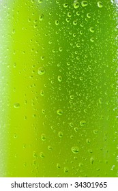 Close up shot of a wet bottle with tropical drink