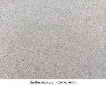 Close up shot of wet sand on a beach