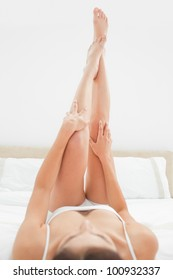 A close up shot, which is focusing on a woman legs and arms as they are raised up fully.