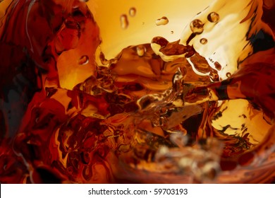 Close up shot of whiskey splashing in glass