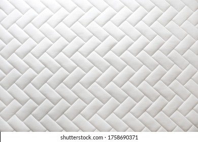 Close up shot of white orthopedic mattress top side surface pattern with a lot of copy space for text. Hypoallergenic foam matress for proper spinal alingment and pressure point relief. Background.