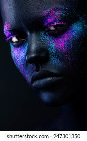 Close up shot of a  woman face with neon make up