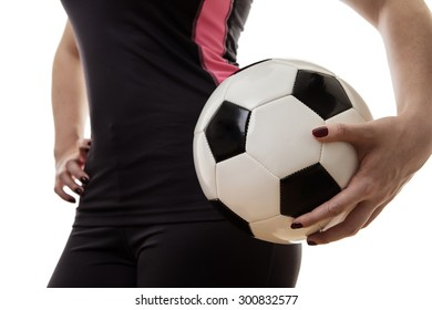 close up shot of woman holding a football to her waist