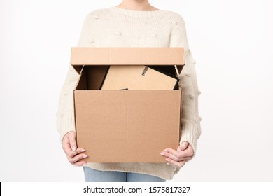 Close up shot of woman holding full cardboard with  copy space for handwriting. Moving day concept. Delivery of online order. Front view