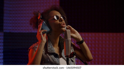 Close up shot of woman singing in recording booth
