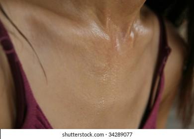 Close up shot of a woman's sweaty body.