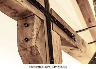 close up shot of a wooden cross beam joint within a wooden cabin.