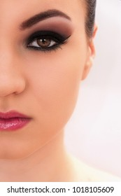 Close up shot of a young beautiful model with professional make up, on the white background