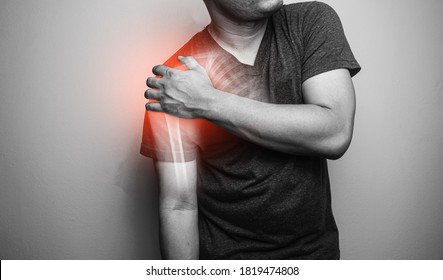Close up Shoulder and clavicle fracture pain in a man, Young man holding his shoulder in pain  Shoulder  inflammation symptoms medical healthcare concept.