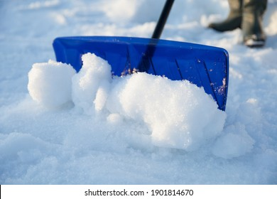 close up of a shovel removing snow