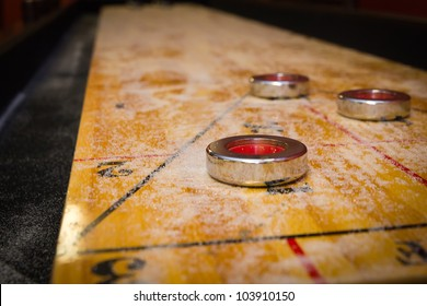 Close up of a shuffleboard game with a small depth-of-field for dramatic effect.