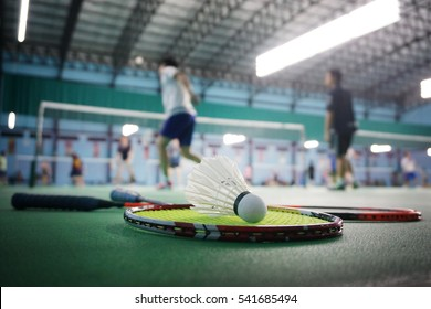 Close up shuttlecocks on racket badmintons at badminton courts with players competing
