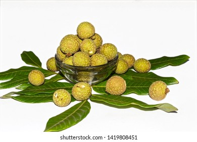 Close up and side angle view of longan or Dimocarpus longan fruits in a glass bowl on white isolated background.
