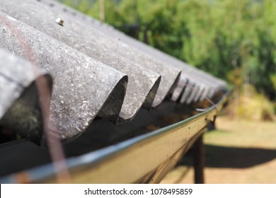 Close up side of grey wavy cement fiberglaas roof tiles
