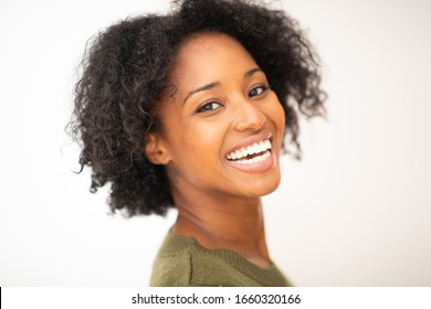 Close up side portrait happy young african american woman on isolated white background