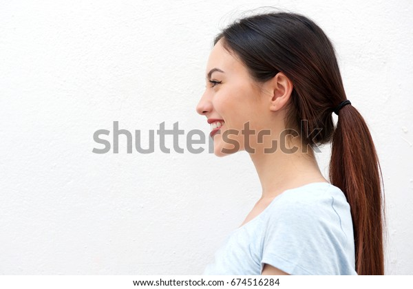 Close up side portrait of healthy young woman with long hair smiling