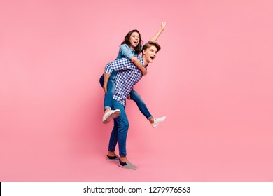Close up side profile full length body size photo of piggy back hug she her he him his lady guy hurry to help superhero fly concept wearing casual jeans denim plaid shirts isolated on rose background