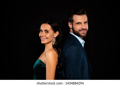 Close up side profile photo amazing pair she her classy he him his macho tenderness stand back to back sincere kind wear blue plaid costume jacket green glossy velvet dress isolated black background