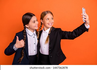 Close up side profile photo beautiful she her little sisters lady hand arm thumb up symbol telephone make take selfies wear formalwear shirt blazer school form bag isolated bright orange background