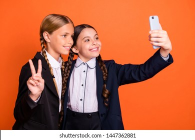 Close up side profile photo beautiful she her little sisters lady hand arm v-sign symbol telephone make take selfies wear formalwear shirt blazer school form bag isolated bright orange background