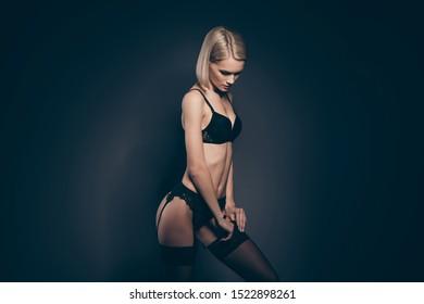 Close up side profile photo beautiful half naked she her lady seductive look mistress lace bikini bra fix stockings dressing suspenders tender skinny shapes isolated dark black grey background