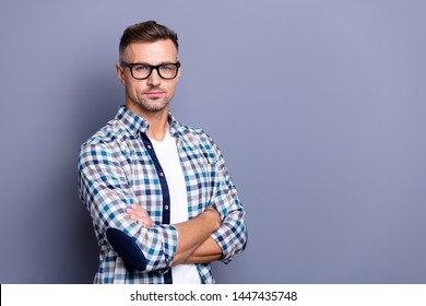 Close up side profile photo intelligent he him his guy arms crossed reliable strict manager not smile self-confident self-assured wear specs casual plaid checkered shirt isolated grey background