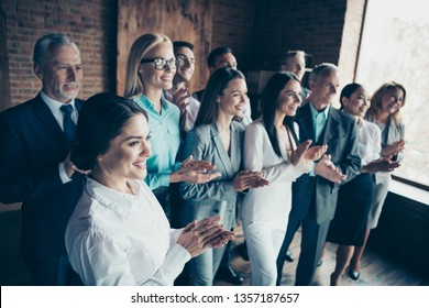 Close up side profile view photo different age mixed race business people stand she her he him his together best brigade show appreciation clap hands arms project power formal wear jackets shirts