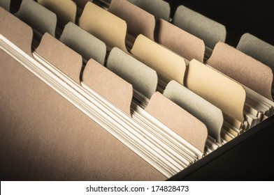 Close up side view of blank card index at slight angle.  Low saturation hues and vignette applied to give a vintage feel.  Left blank to provide copy space.