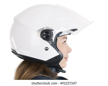 Close up side view at female motorcyclist in white open helmet, isolated on white background